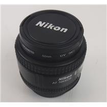 Nikon AF Nikkor 24mm 1:2.8 D Lens with Caps and Promaster 52mm UV Filter