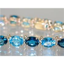 B002, London & Swiss Blue Topaz Gold bracelet