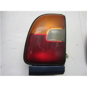 FOR 1996-1997 TOYOTA RAV-4 LEFT HAND SIDE TAILLIGHT. SMUDGE ON LENS